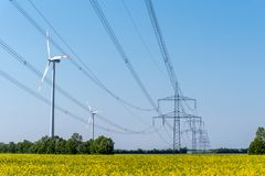Power supply lines and some wind turbines royalty free stock image