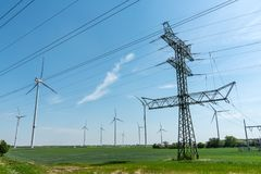 Power supply lines and wind turbines royalty free stock photos