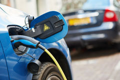 Power supply plugged into an electric car during charging stock photo