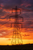 Power supply under apocalyptic looking skies Royalty Free Stock Images