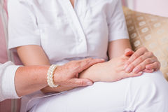 The power of supportive touch. Close shot of an elder woman's hand touching the nurses forearm Royalty Free Stock Photography