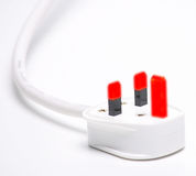 Power Surge. Glowing pins on a 13 amp plug as used in the UK Stock Photos