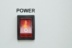 Power switch. Front device panel with detailed red power switch button stock image