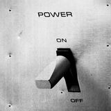 Power switch on metal panel Stock Photography