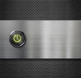 Power switch or start button on metal background Royalty Free Stock Image