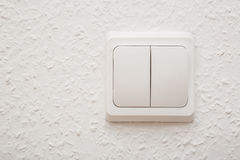 Power switch on white wall Royalty Free Stock Photography