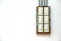 Power switch on the white wall. Royalty Free Stock Photography