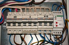 Power switches for high-voltage network with connected wires. Industrial background. royalty free stock image