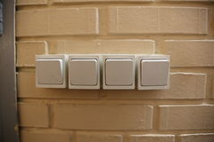 Power switches in a row Stock Photos