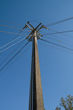 Power and Telephone Pole Intersection. Power distribution and telephone pole at line intersection Stock Image