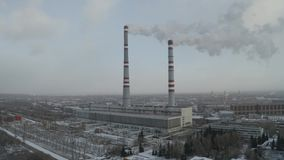Power thermal plant. Power plant and heat station two pipe smoking winter, D-log aerial view stock video