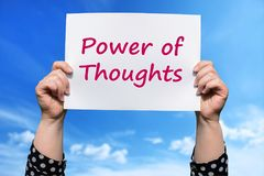 Power of Thoughts. Motivational sign woman holding by hand stock photo