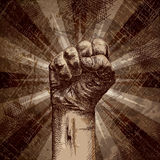 Power to the people. Clenched fist on grunge background as a symbol of strength, will, change Royalty Free Stock Images