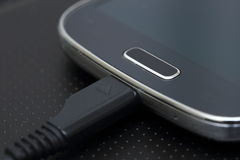 USB cable on modern smartphone Royalty Free Stock Photos