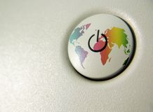 Power to the world. Turn on/off single button with world map Stock Photo