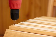 Power Tool. Drilling Down a Screw into Wood Stock Photos