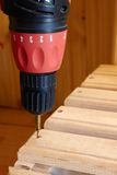 Power Tool. Drilling Down a Screw into Wood Stock Photo