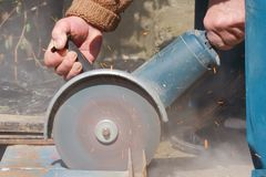 Power tool. Cutting through metal using power tool Stock Image