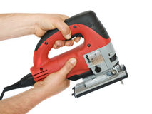 Power tool. Two hands are at work with power saw Stock Images