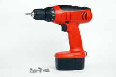 Power Tool and Drill Bits. A power tool and a set of drill bits on a white background Stock Photography