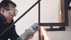 Power tool grinder worker cuts metal sparks. Power tool grinder worker cuts metal railing stairs with sparks industry drive power stock video footage