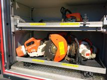 Power Tools, Chainsaws and Other Heavy Duty Equipment. A variety of handheld power tools stored in a compartment of a fire truck Royalty Free Stock Photography