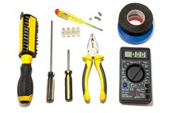 Power tools for repair and installation of electricians. A set of tools for the repair and installation of electricians: screwdrivers, pliers, electrical tape stock photo