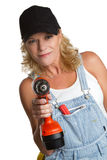 Power Tools Woman. Isolated woman using power tools stock photography