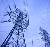 Power tower. Electricity tower in the blue sky and white clouds Stock Images