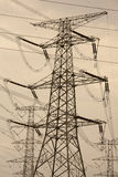 Power tower. Electricity tower silhouette in the yellow background Royalty Free Stock Photography