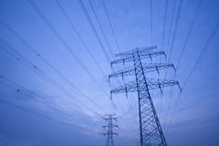 Power tower. Electricity tower in the blue sky and white clouds stock photo