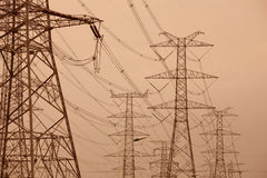 Power tower. The electricity tower group under the brown background royalty free stock photography