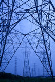 Power tower. The electricity tower group under the blue background Royalty Free Stock Photos