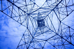 Power tower. Electricity tower in the blue sky and white clouds Royalty Free Stock Photography