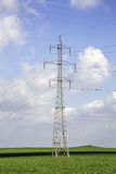 Power tower. In a beautiful green  fild Stock Photography