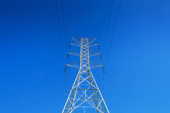 Power Tower LA CA. Electrical Power Tower with high tension lines. Low angle perspective of superstructure against cloudless blue sky. Negative space.  Landscape Royalty Free Stock Image