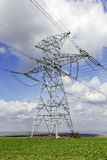Power tower. In a rural field Stock Photo