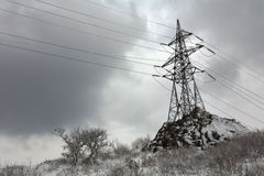 Power tower after snowfall Royalty Free Stock Photo