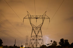 Power Tower During a Summer Storm with Lightning Stock Images
