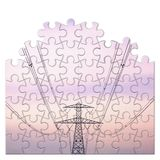 Power tower and transmission lines - concept image in jigsaw puzzle shape.  stock photography
