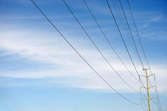 Power towers against blue sky. Power towers and power lines against blue sky Royalty Free Stock Photos