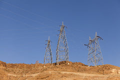 Power towers on top of a rocky mountain in golden light of morni Stock Photography