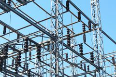 Power transfer station looking across at an open grid structure Stock Photo