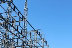 Power transfer station looking up against a blue sky. Horizontal aspect Stock Photo