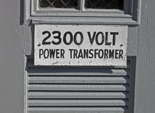 Power transformator 2300 volt, text on signboard, Stock Image