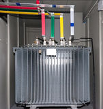 Power transformer in the compartment. Of steel. New electrical equipment royalty free stock photos