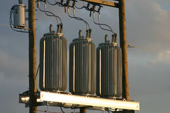 Power transformers at Sunset Stock Images