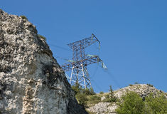 Power transmission line. Reliance power lines on the mountain Stock Photos