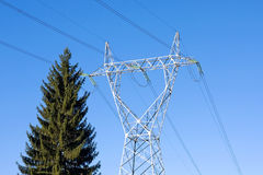 Power transmission line. Along with a pine tree - good for pollution, ecology and enviroment concepts stock photo