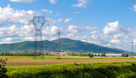 Power transmission line against a Vosges mountains background Royalty Free Stock Photography